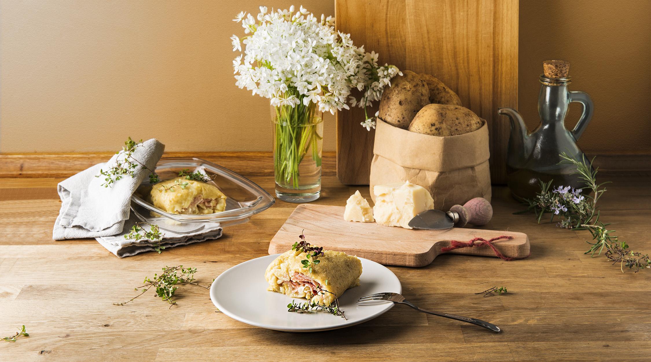 La Trentina | Rotolo di patate, speck cotto e formaggio | Hotel Lupo Bianco